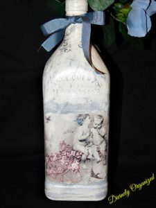 Angels Among Us Black Background Bottle Close Up View 1 PM